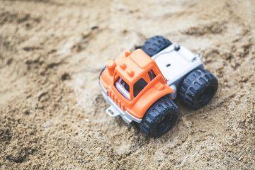 child's toy on beach