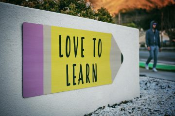 sign saying Love to Learn